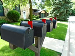 4 mailboxes with red flags
